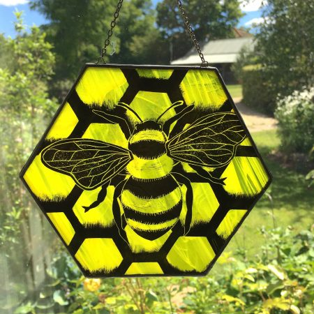 Stained glass honey bee sun catcher in window