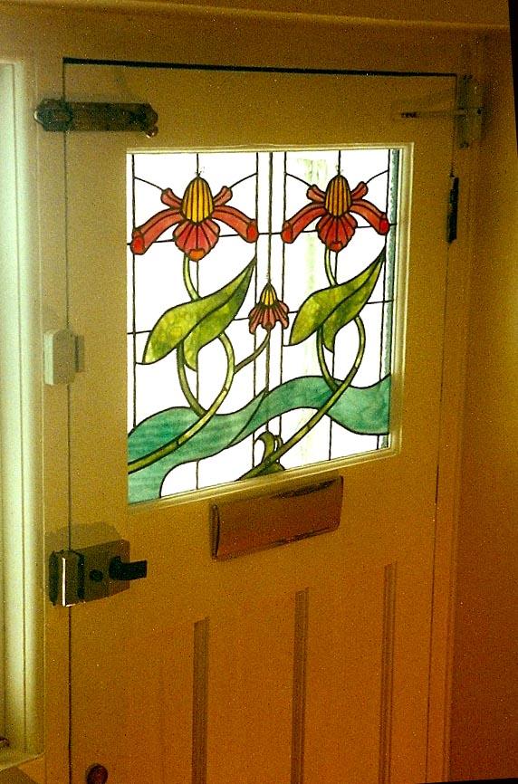 Front door design inspired by Aubrey Beardsley