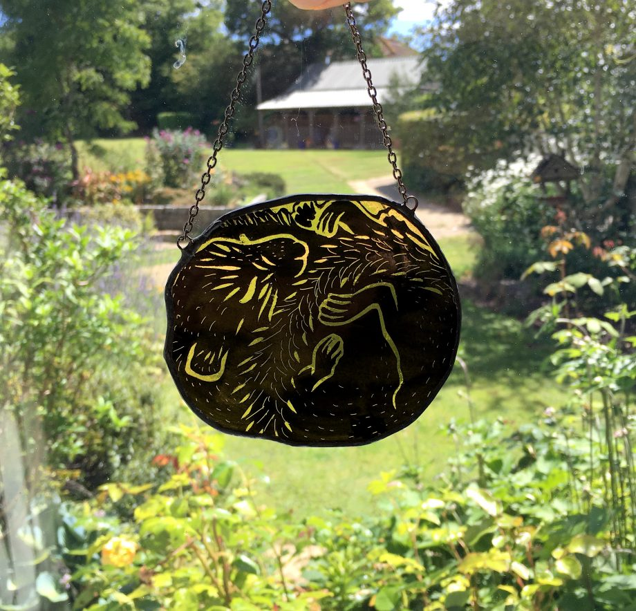 Stained glass sleeping field mouse sun catcher in window