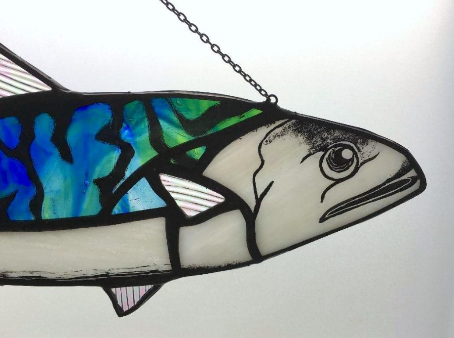 Close up of head stained glass mackerel sun catcher