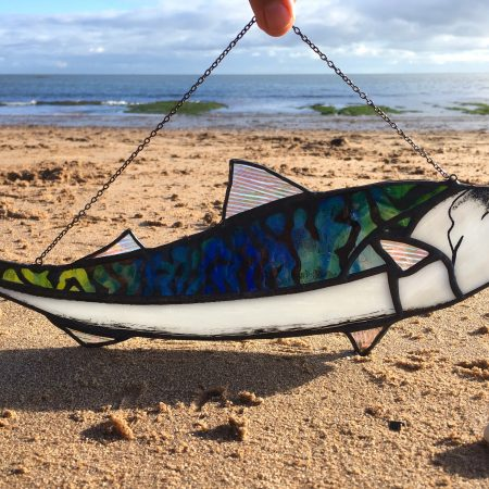 Mackerel stained glass sun catcher on beach