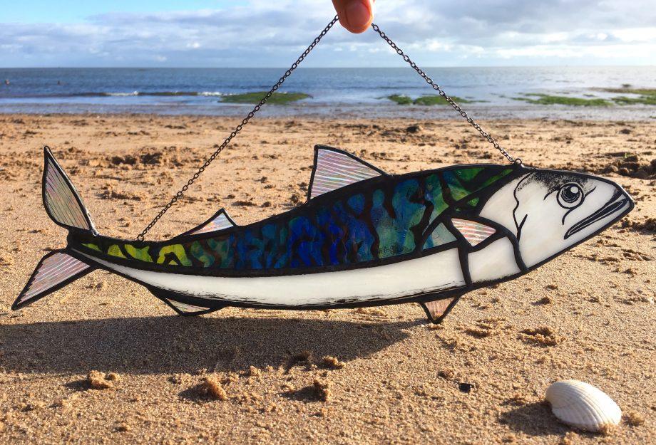 Mackerel stained glass sun catcher on beach
