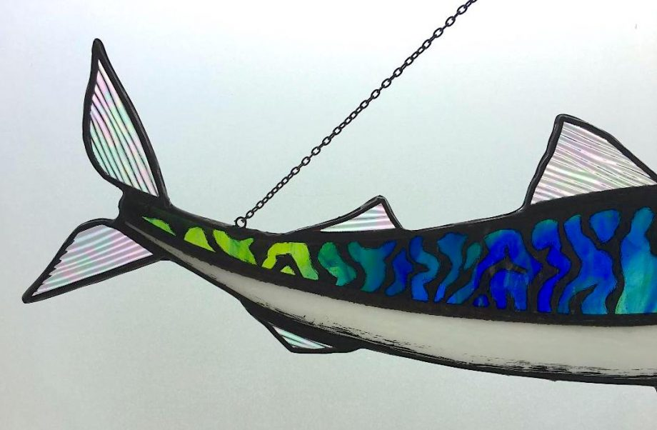 Close up on mackerel tail stained glass sun catcher