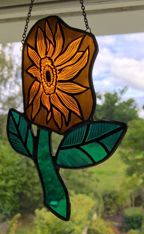 Orange stained glass sunflower suncatchder