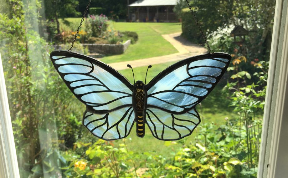 White stained glass butterfly sun catcher
