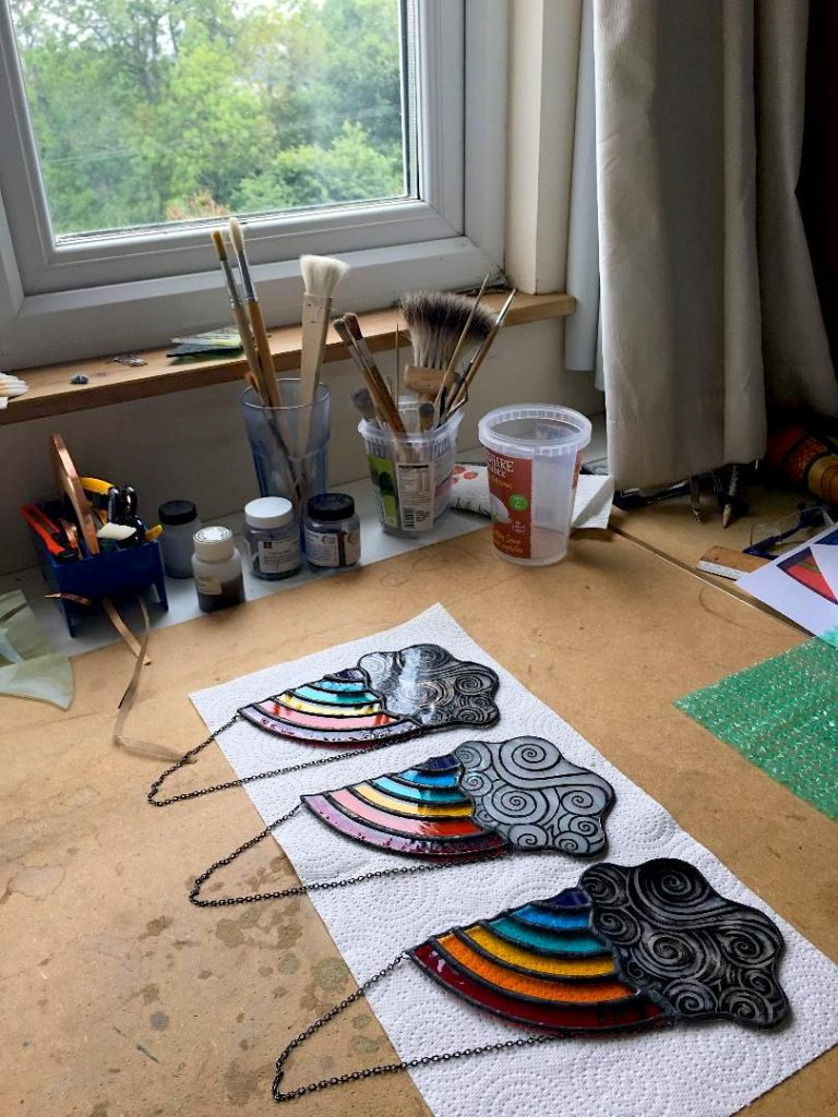 Three stained glass rainbows in studio