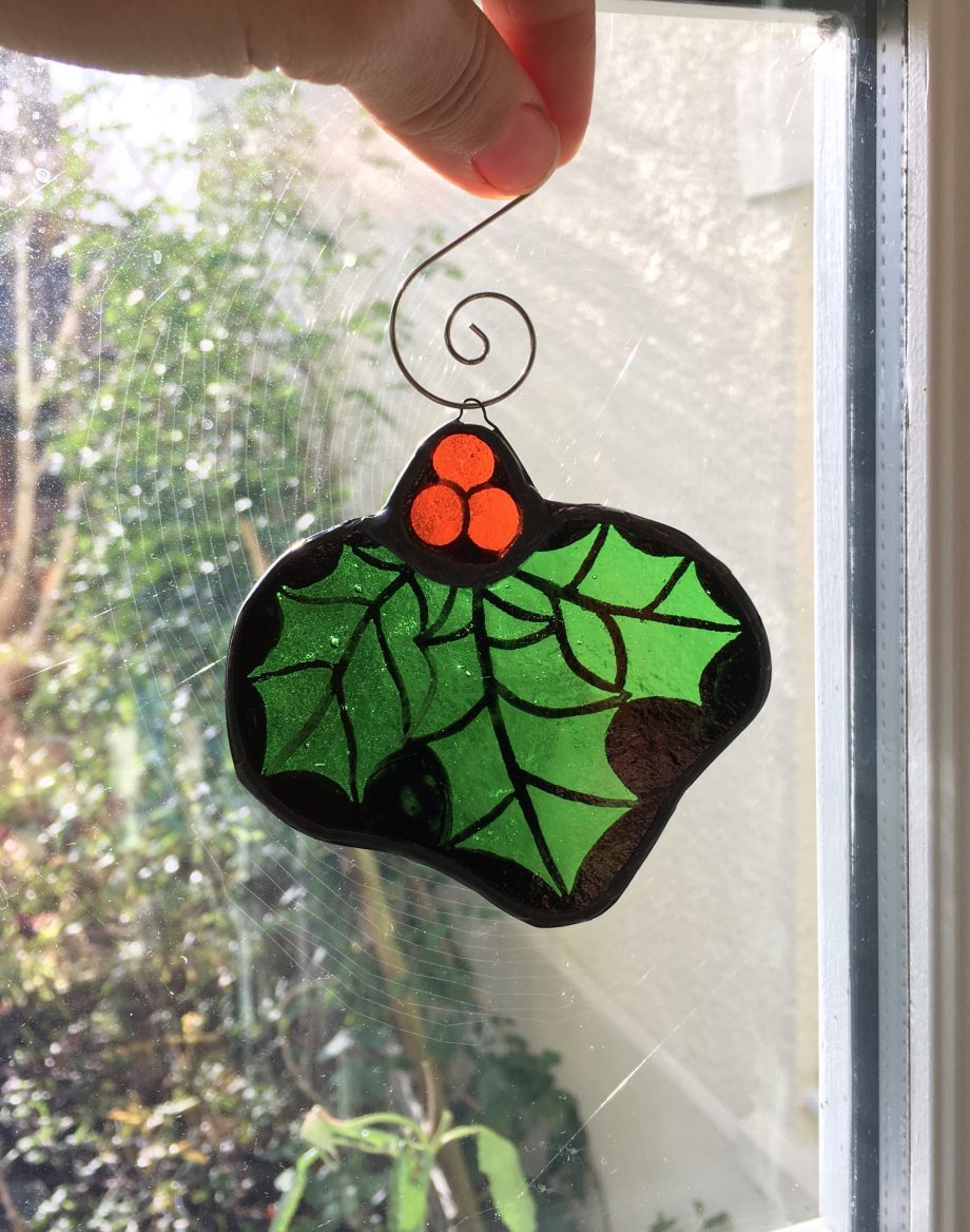 Stained glass xmas holly in window