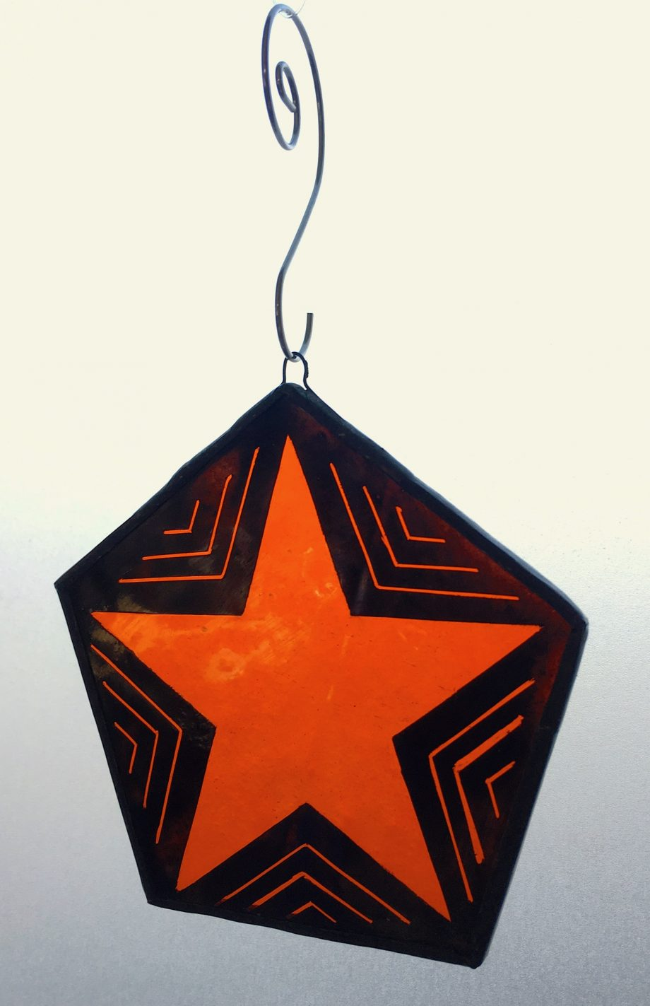 Orange star stained glass Christmas tree decoration
