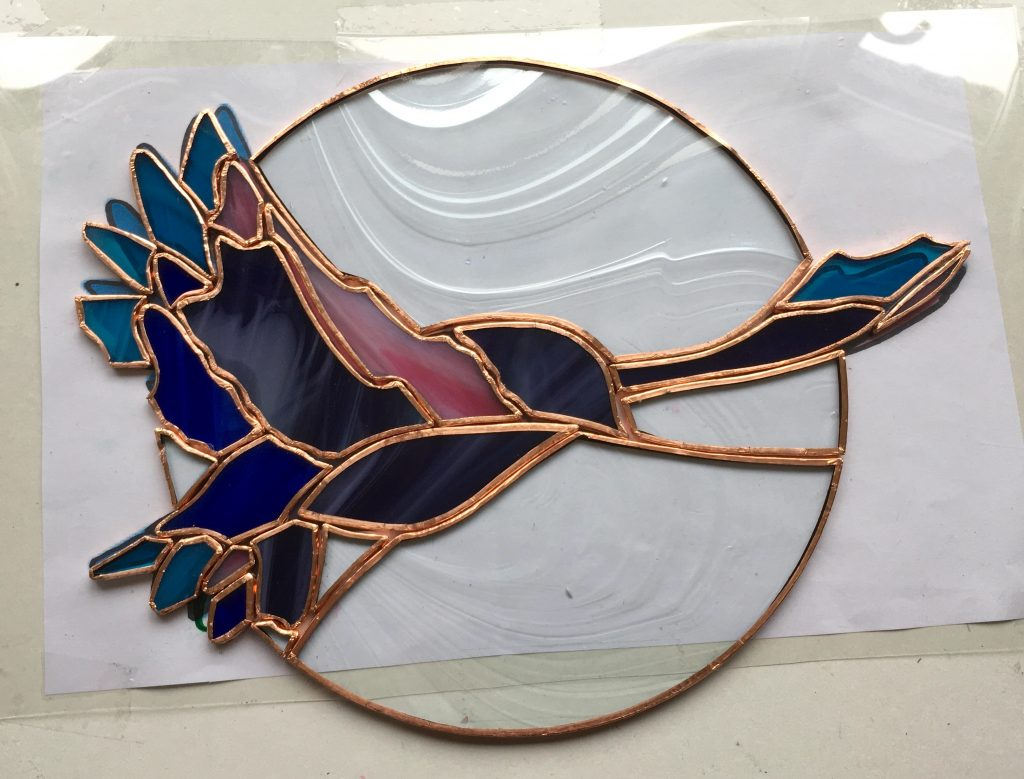 Flying free copper foiled bird